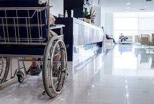elderly man on wheelchair in nursing home